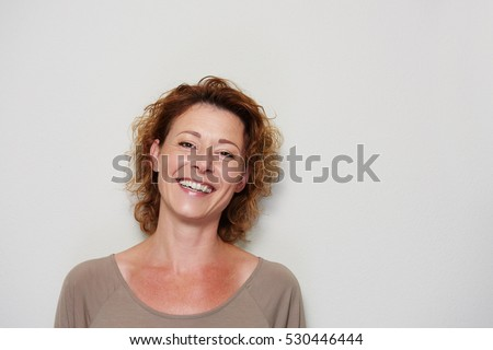 Close up portrait of smiling brunette woman on white background #530446444