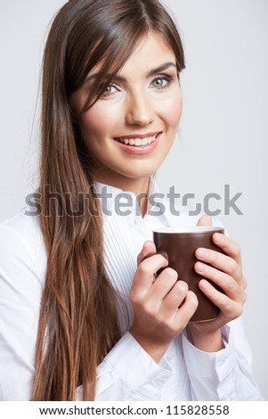 Close up Portrait of smiling business woman, isolated on gray background with coffee cup.