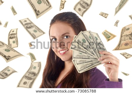 Close up portrait of smiling girl with dollar's banknotes on falling dollars background