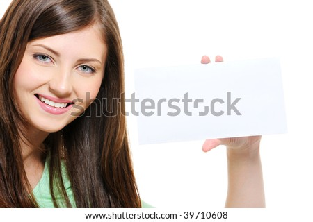 Close-up portrait of smiling young beauty girl holding white card