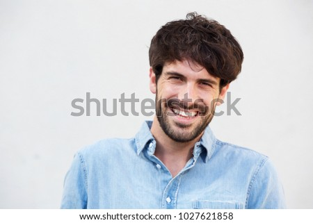 Close up portrait of smiling young man with beard against white background #1027621858