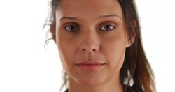 Close up portrait of somber girl on white background with copyspace