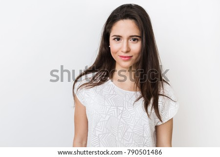 close up portrait of stylish young pretty woman smiling in white t-shirt, isolated, natural look, long brown hair