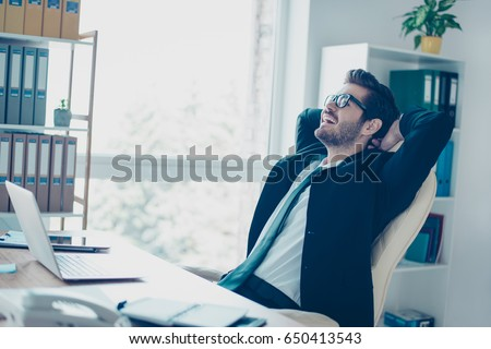 Close up portrait of successful businessman resting at his office. He finished big project, so can rest now
