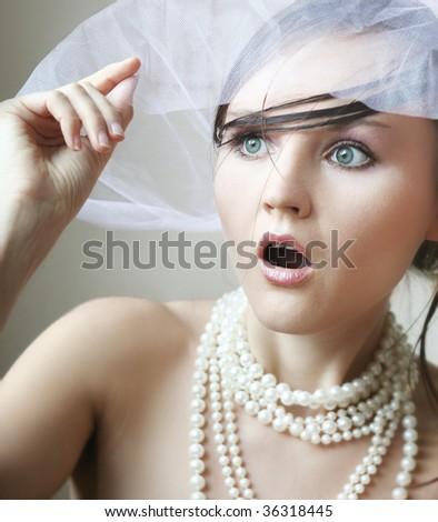 Close-up portrait of surprised woman - stock photo