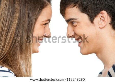 Close up portrait of teen couple facing each other.Isolated