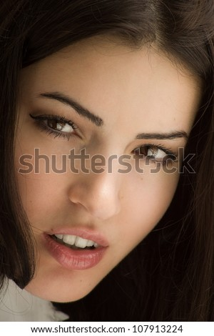 Close up portrait of the beautiful brunette - stock photo