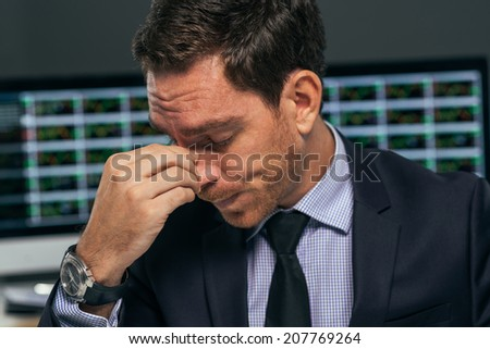Close-up portrait of tired stock market trader