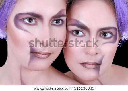 close up portrait of two beautiful girls twins