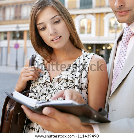 Close up portrait of two business people having a meeting in a classic city center.