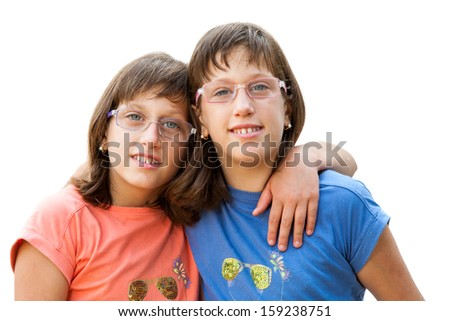 Close up portrait of two young handicapped twin sisters.Isolated on white background.