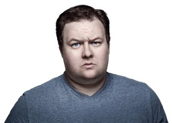 Close-up portrait of white Caucasian big fat stout man with blue eyes looking in camera, skeptical suspicious expression, emotion. Isolated on white background.
