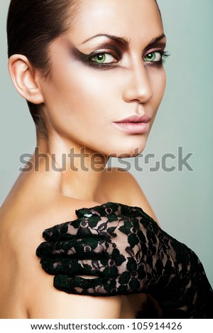 close up portrait of woman in glove with green eyes