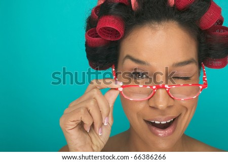 Close up portrait of woman winking - stock photo
