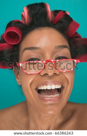 Close up portrait of woman with rollers in hair