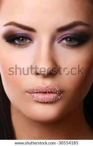 close-up portrait of  young adult with beautiful make-up