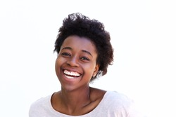 Close up portrait of young african american woman laughing against white background