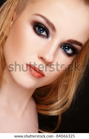 Close-up portrait of young beautiful blond girl with trendy make-up
