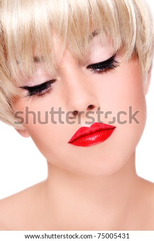 Close-up portrait of young beautiful blond woman with red lipstick
