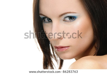 Close-up portrait of young beautiful dark-haired woman against white background.