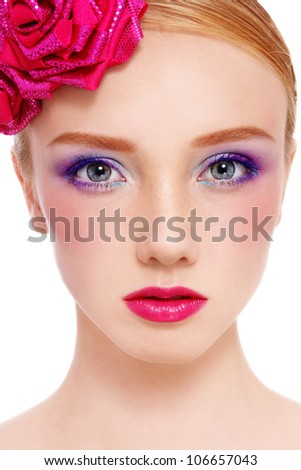 Close-up portrait of young beautiful fresh girl with colorful make-up