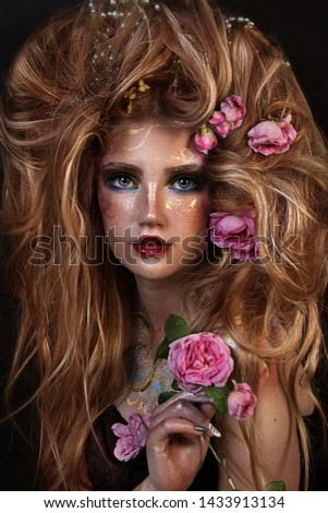 close up portrait of young beautiful girl with flower professional makeup. elf princess with flower crown on head.  bright face art. spring fairy of flowers. lush hairdo with roses