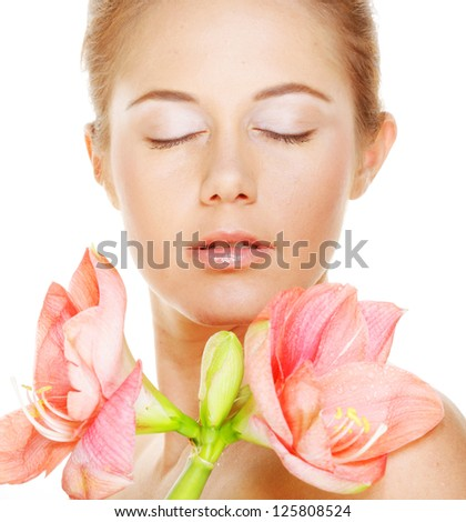 Close-up portrait of young beautiful woman holding pink flower. Isolated on white background