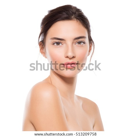 Close up portrait of young beautiful woman looking ta camera. Face of beauty girl isolated on white background. Youth and skin care concept #513209758