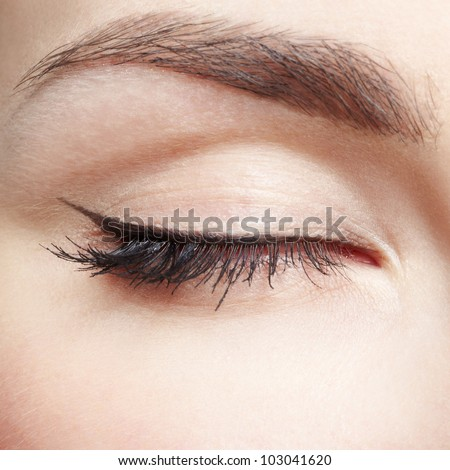 close-up portrait of young beautiful woman's eye zone make up