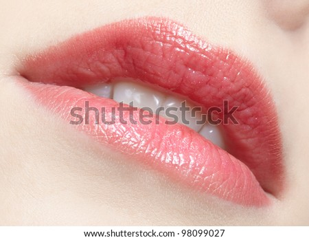 close-up portrait of young beautiful woman's lips zone make up