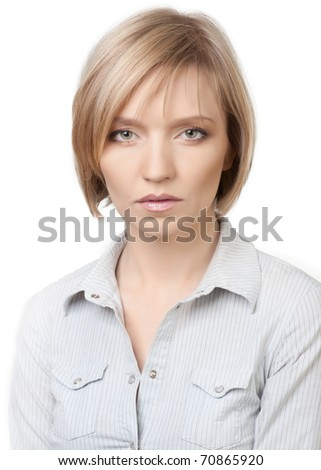 Close-up portrait of young beautiful woman with natural make-up against white background