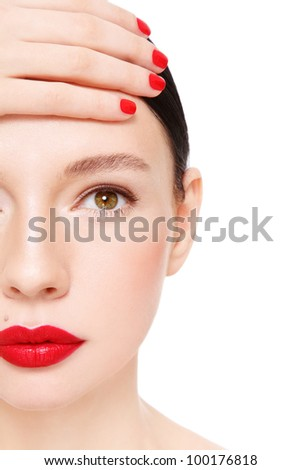 Close-up portrait of young beautiful woman with red lipstick, over white background
