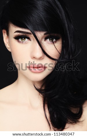 Close-up portrait of young beautiful woman with trendy make-up and hairstyle