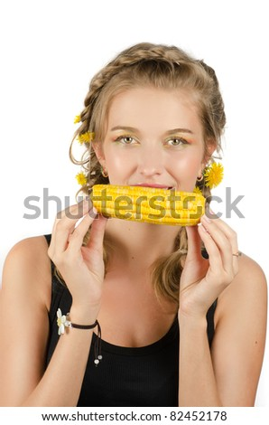Close-up portrait of young beauty woman eating corn-cob on a white