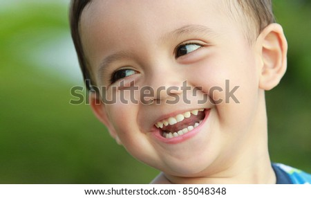 close up portrait of young boy smiling