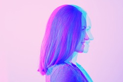close-up portrait of young brunette woman in profile in neon light effect glitch, duotone