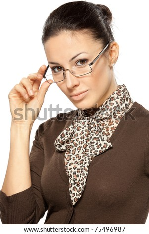 Close-up portrait of young business woman holding her eye-glasses side isolated on white