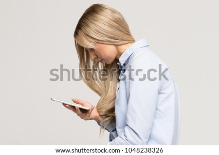 Close up portrait of young Caucasian woman looking and using smart phone with scoliosis, side view/Rachiocampsis/Kyphosis curvature of the spine/Incorrect posture, scoliosis,  orthopedics concept