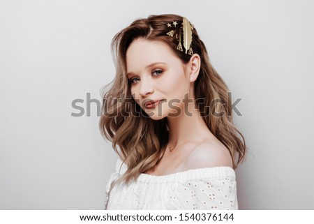 Close up portrait of young cheerful beautiful girl with dark long hair with happy and relaxed face expression Stockfoto ©
