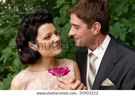 Close-up portrait of young couple outdoors. Woman tenderly lookingat the man. Find other nice peoples photos in my portfolio.