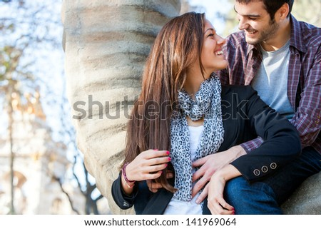 Close up portrait of young couple sharing quality time together in park.