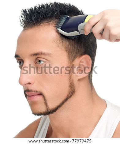 Close up portrait of young handsome man with perfect skin and hair. Cutting hairs.