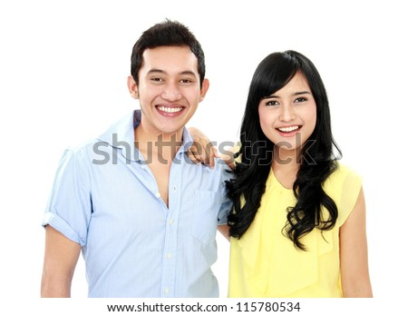 close up portrait of young happy couple isolated on white background - stock photo