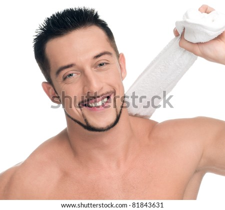 Close up portrait of young happy man face with perfect skin and towel. Isolated on white