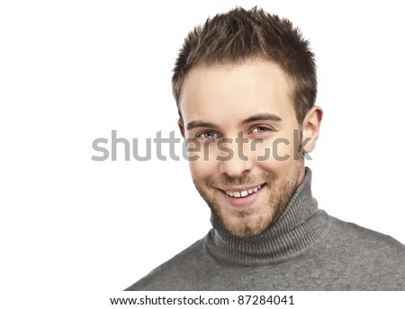 Close-up portrait of young happy man isolated on white background.