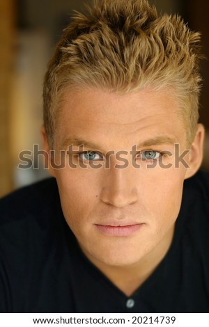 Close-up portrait of young male model in black shirt #20214739