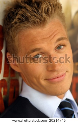 Close-up portrait of young male model with slight smile