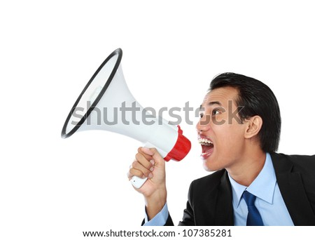 close up portrait of young man shouting using megaphone isolated on white background