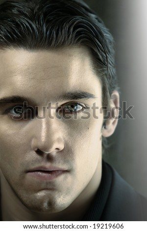 Close up portrait of young man staring into the lens