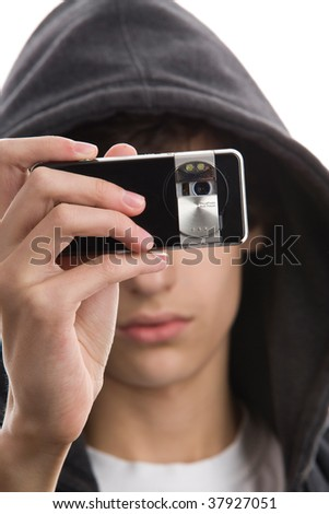Close-up portrait of young man wearing hooded sweatshirt taking a picture using phone camera